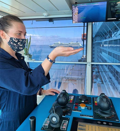 Officer on the bridge of Celebrity Edge Wearing Mask