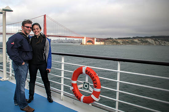 Larissa and Billy on Oceania Regatta sailing out of San Francisco passed the Golden Gate Bridge