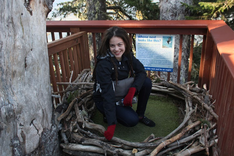 Larissa in a Recreated Bald Eagle's Nest at the Mount Roberts Nature Center