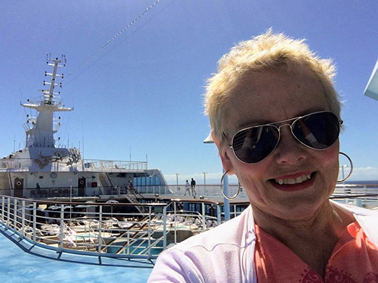 My mom enjoying the sub one deck above the aft end of the pool area on Oceania Sirena