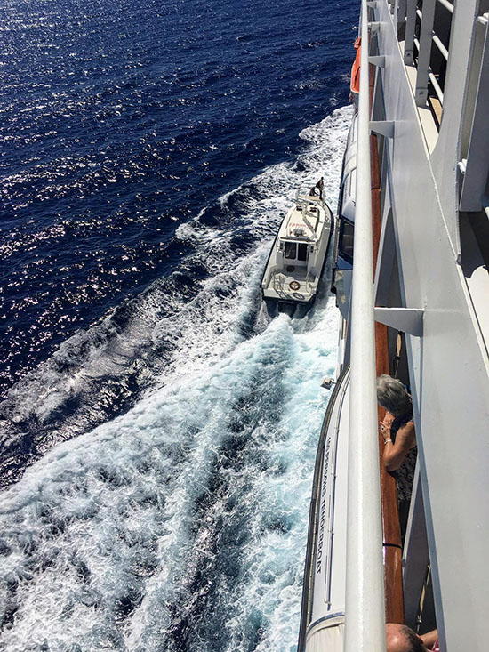 A pilot boards Oceania Sirena in New Caledonia on Oceania Sirena. This fascination must run in the family.
