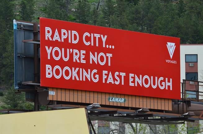 "Virgin Voyages South Dakota Billboard - ""Rapid City.... You're not booking fast enough"""
