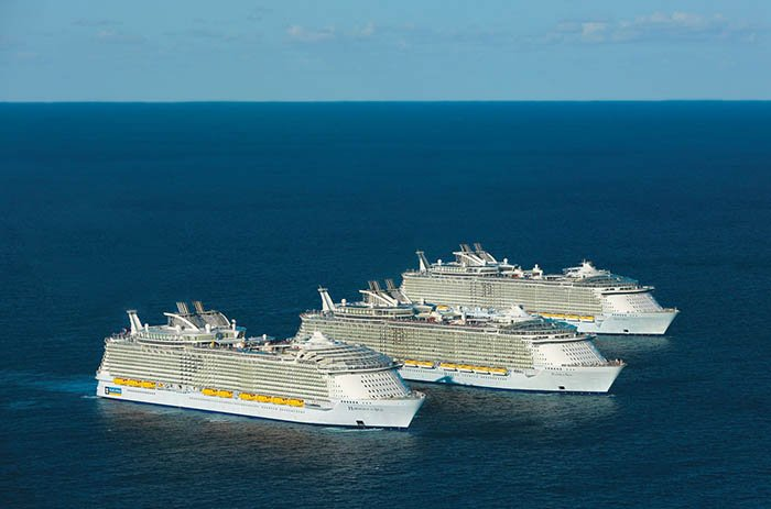 Oasis of The Seas, Allure of The Seas, and Harmony of The Seas next to each other at sea