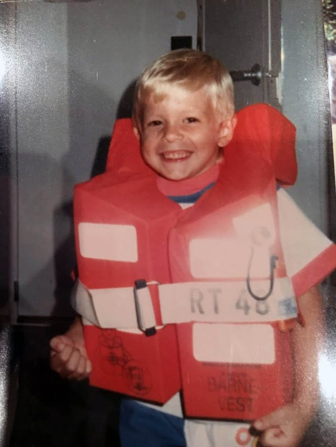 Billy wearing life vest